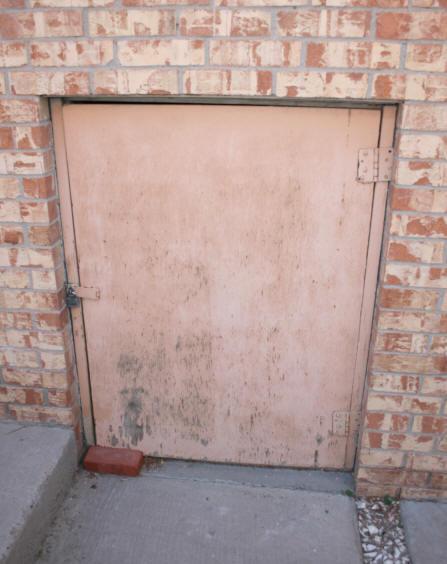existing warped door on crawl space