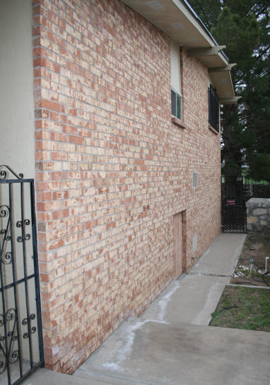 West Side Of House Showing Crawl Space Door