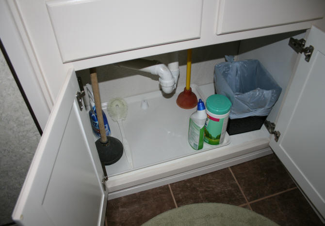 of a fiberglass tray and alarm under the main bathroom sink  So now if there is a leak  the water will hit the tray first and the alarm will go off. Laurel  39 s Adventures in Home Repair   Leak in main bathroom sink