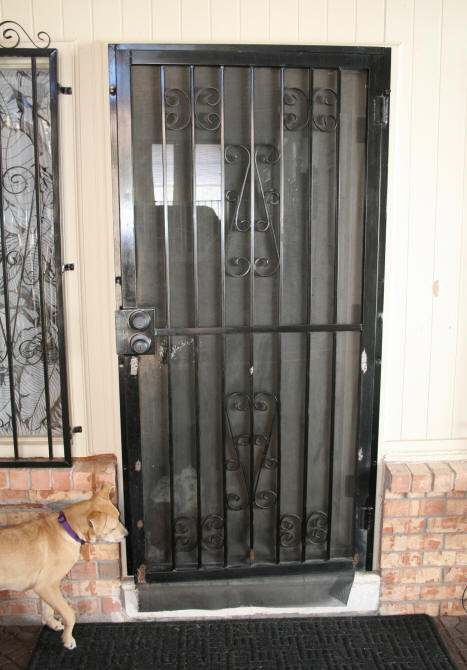 when i was working on the front door as part of my doors project i took a really good look at the wrought iron screen door that shares the same door frame