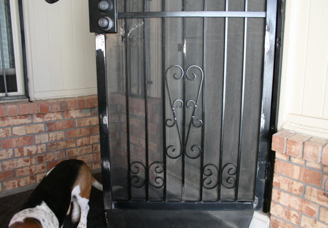 Screen Door With Hole Areas Sanded Down To Bare Metal