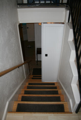 Door at bottom of stairs